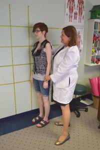 Dr. Cora Huitt assisting in proper poster