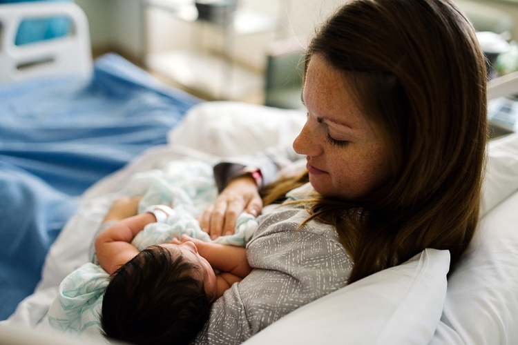 photo-of-a-new-mom-holding-her-baby-by-Bjorna-Hoen